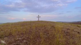 Cross on top of the hill stock video footage