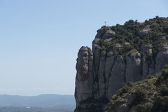 A cross on the top of Montserrat stock photography
