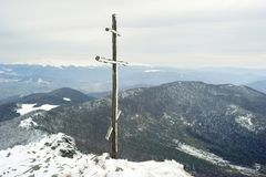 Cross on top of the mountain Royalty Free Stock Photography