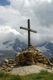 Cross on top of mountain Stock Image