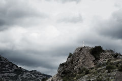 Cross on the top of the mountain Royalty Free Stock Image