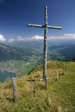 Cross on top of mountain. A wooden cross standing on top of Rigi mountain in Switzerland stock images