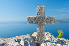Cross on top of the mountain above sea level Royalty Free Stock Photo