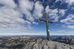 Cross at the top of a mountain. A cross at the top of a mountain on a clear day with blue skies and a few clouds Stock Photography