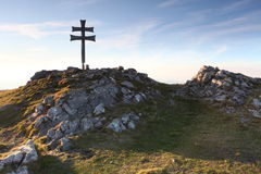 Cross on top of mountain - Klak Stock Images
