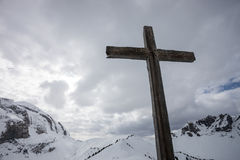 Cross on top of swiss mountain peak Stock Images