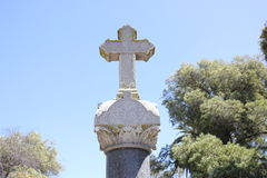 Cross on top of tombstone Stock Photography