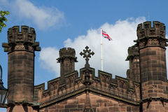 Cross, towers and flag. Stock Photography