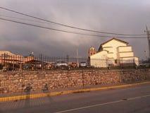 cross track near church in sunset stock photography