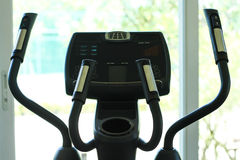Cross trainer. In row with a garden viwe Stock Images