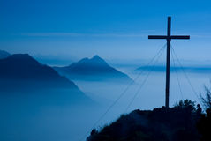 Cross in twilight. Gorgeous sunset in Swiss Alps. Rigi Hochflue Royalty Free Stock Photos