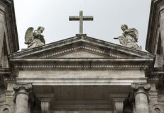 Cross and two stone angels Royalty Free Stock Images
