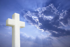 Cross under Bright sunlight shining through clouds. Jesus died on the cross for our sins Royalty Free Stock Photos