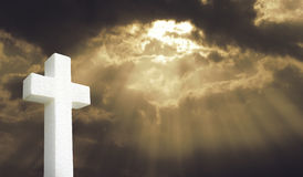 Cross under Bright sunlight shining through clouds. Jesus died on the cross for our sins Royalty Free Stock Images