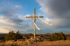 Cross under dramatic sky on the Easter pilgrimage route to Chimayo, New Mexico royalty free stock photography