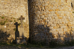 A cross under the walls of the citadel Stock Image