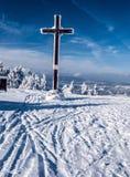 Cross on Velka Raca hill in winter Kysucke Beskydy mountains on slovakian - polish borders. Cross on Velka Raca hill in Kysucke Beskydy mountains on slovakian Royalty Free Stock Photos