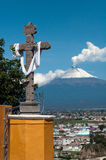 Cross and the volcan Stock Images