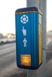 Cross walk button. Blue and yellow cross walk button Royalty Free Stock Images