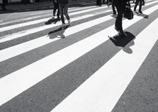 Cross walk with people walking Road traffic Safety sign royalty free stock photos