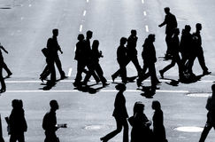 The Cross Walkers #2. Business people in the cross walk royalty free stock image