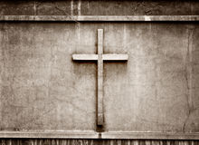 Cross on wall background Stock Photo