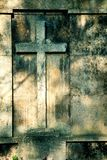 Cross on wall background Royalty Free Stock Photos