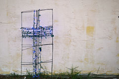 Cross and Wall background. Blue Christmas lights make a beautiful cross in from of an stucco wall Stock Photography