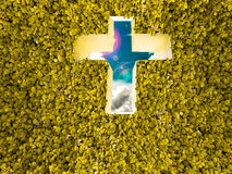Cross wall and clover yellow background Stock Photos