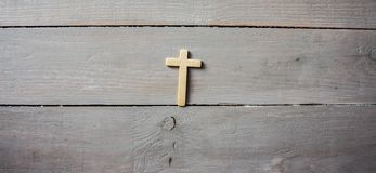 A cross on a wall stock photo