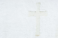 Cross on wall Stock Photos