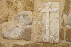 Cross on wall of a medieval church Royalty Free Stock Photo