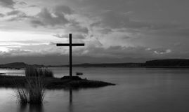 Cross Waters. Still morning water in this image of a cross Royalty Free Stock Photography