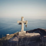 Cross on the way Camino de Santiago. Cross standing on a rock on the shore of the Atlantic Ocean. The pilgrimage route Camino de Santiago Stock Image
