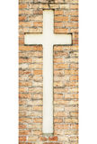 Cross on the weathered red brick wall Royalty Free Stock Images