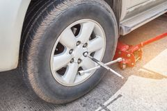 Cross wheel wrench changing tire Stock Image