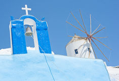 Cross and Windmill in Greece. An image of a Christian Cross and windmill side by side. The image also has a secondary religious message the cross has power to stock image