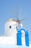 Cross and Windmill side by side. Stock Photography