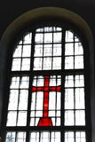 Cross at a window Stock Photo