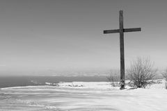 Cross in wintry landscape Stock Images