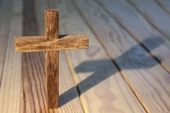 Cross on wood table Royalty Free Stock Image