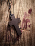 Cross on wooden background Royalty Free Stock Photos