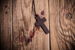 Cross on wooden background Royalty Free Stock Image