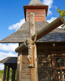 Cross and wooden church. Stock Photography