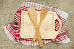 Cross wooden fork and spoon Royalty Free Stock Photography