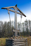 Cross before Wooden orthodox church in name of Cov Stock Images