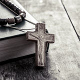 Cross on a wooden surface closeup Stock Photography