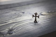 Cross on table. Cross on the wooden table background Stock Photos