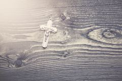 Cross on table. Cross on the wooden table background Royalty Free Stock Image