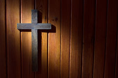Cross on the wooden wall in night easter background Royalty Free Stock Image